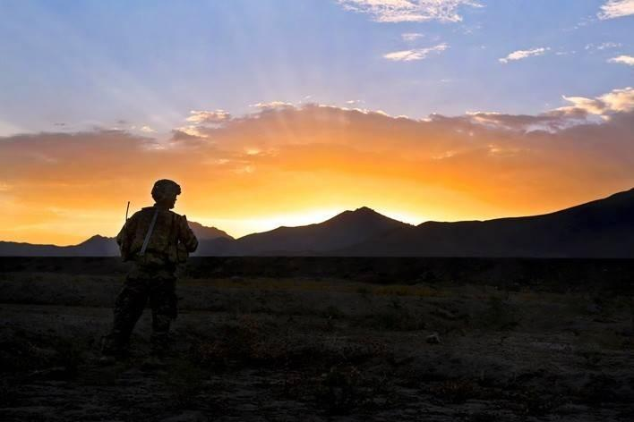 A U.S. soldier takes a break during a mission to clear Route 1 of improvised explosives in Wardak province, Afghanistan.  The soldier, assigned to the 87th Sapper Company, conducted the clearing mission to maintain military & commercial traffic movement.