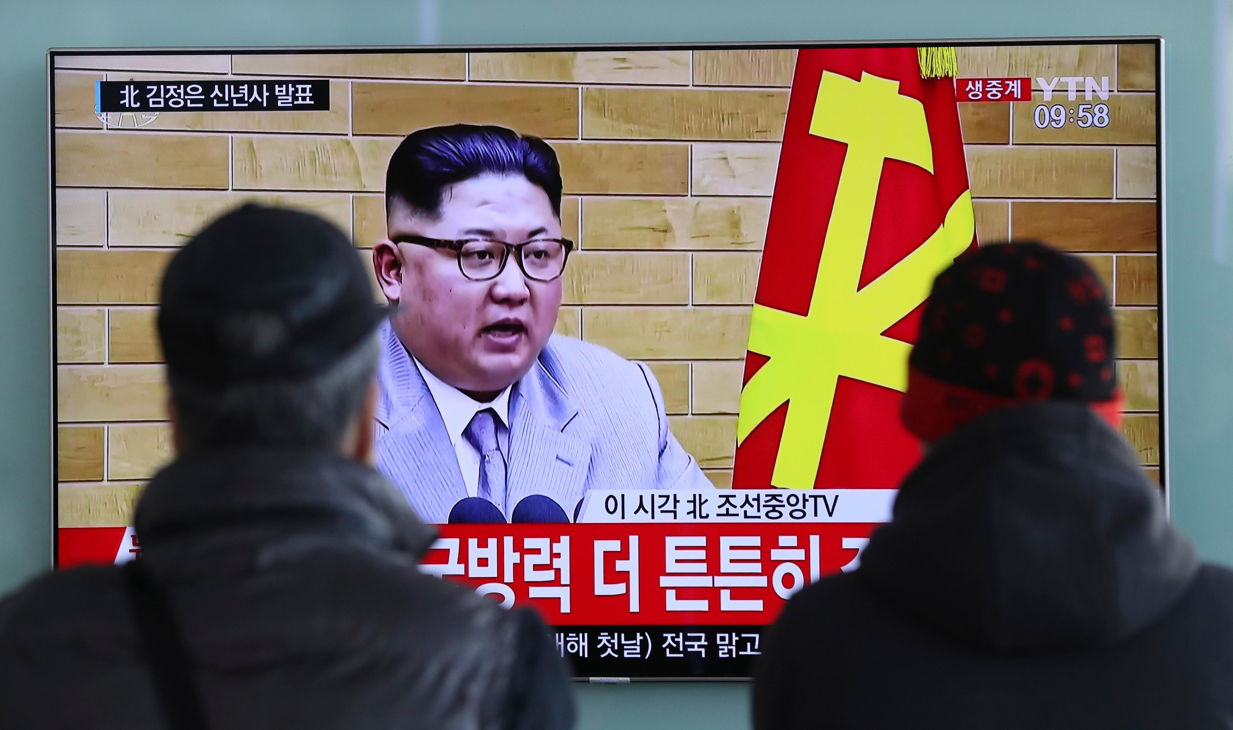 "South Koreans watch a TV news program showing North Korean leader Kim Jong Un's New Year's speech, at the Seoul Railway Station in Seoul, South Korea, Monday, Jan. 1, 2018. The letters read on top left, ""Kim Jong Un delivers New Year's speech.""  Kim said Monday the United States should be aware that his country's nuclear forces are now a reality, not a threat. But he also struck a conciliatory tone in his New Year's address, wishing success for the Winter Olympics set to begin in the South in February and suggesting the North may send a delegation to participate.  (AP Photo/Lee Jin-man)"