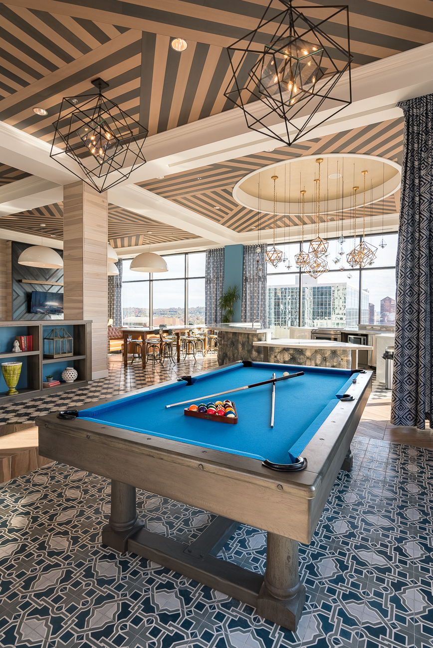 The Sky Club is on the 10th story of the building. It features a circular gourmet kitchen, loads of seating, a pool table, and views of Downtown. / Image: Phil Armstrong, Cincinnati Refined // Published: 11.13.18