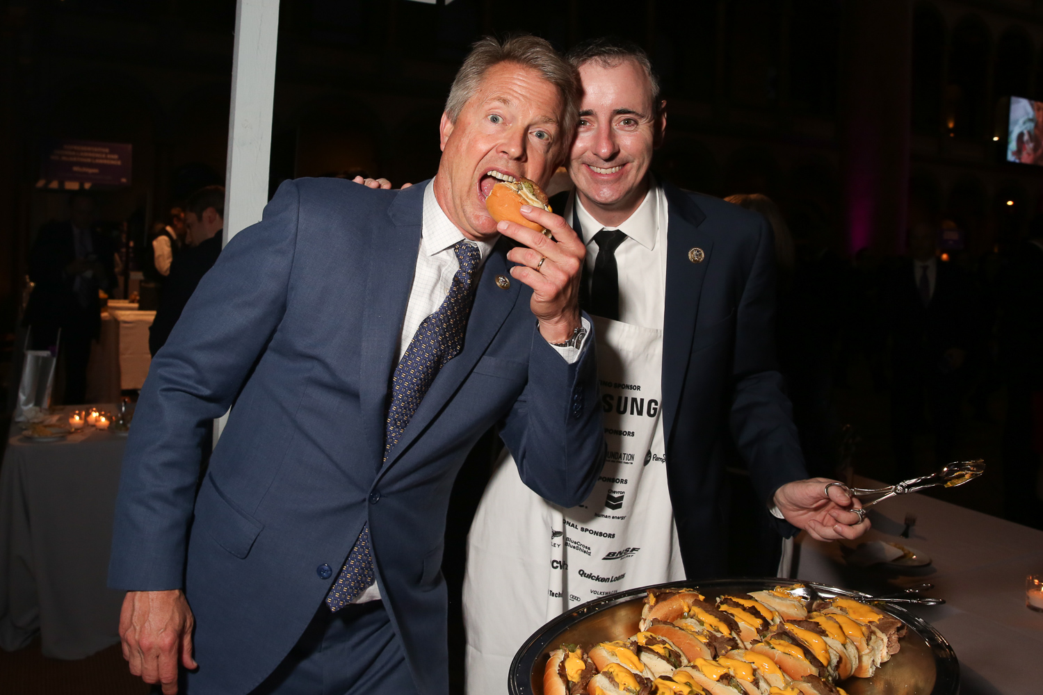 Rep. Roger Marshall chows down on Rep. Brian Fitzpatrick's Philly cheesesteaks.{ }(Amanda Andrade-Rhoades/DC Refined)