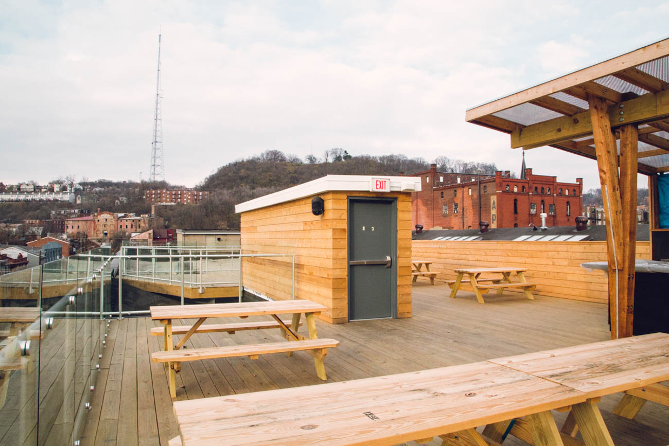 Round out your ultimate Cincinnati rooftop bar crawl at Rhinegeist. Make your way back towards Washington Park, take a left onto Elm Street, and then you're an 11-minute straight shot to the last stop. Arguably one of the most popular rooftops in the city, Rhinegeist offers a casual atmosphere with expansive views of the city. Best of all, the craft brewery is open until 2 AM on weekends, so you and your friends can celebrate your achievement (seven bars is no joke) late into the night with a few Cincinnati-brewed beers under the stars. ADDRESS: 1910 Elm Street (45202) / Image: Catherine Viox // Published: 6.25.19