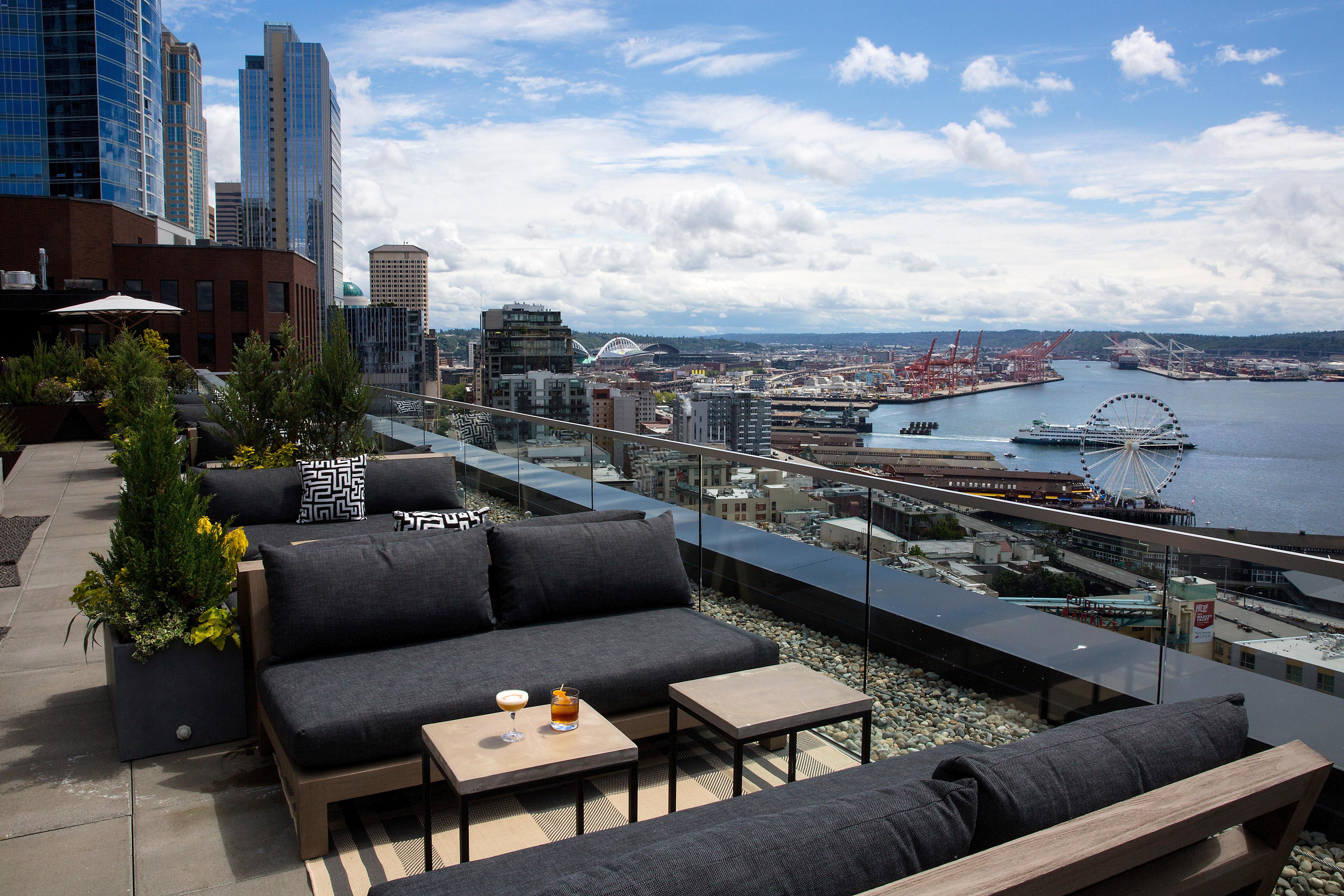 Forget sending out-of-towners to the Space Needle, send them to The Nest at The Thompson Hotel! It first opened a year ago, and quickly became the go-to spot for folks hoping to catch a glimpse of the panoramic views of downtown Seattle skyline, Puget Sound and Olympic Mountains. They've recently relaunched with a redesigned space and completely new furniture and a brand new food menu - but don't worry, the view is still the same! The Nest is renowned local chef Josh Henderson's rooftop bar and lounge located in the Thompson Seattle hotel, and is open to the public every day between 3 p.m. to midnight.  (Image: Sy Bean / Seattle Refined)