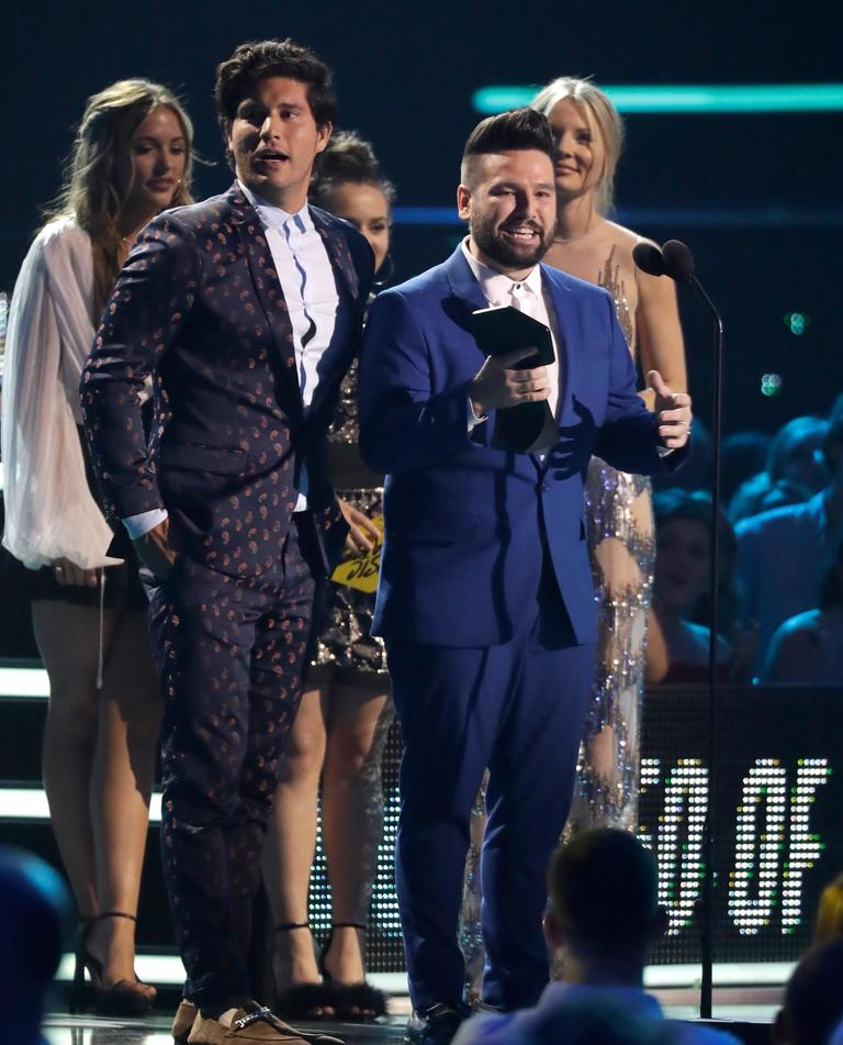 "Dan Smyers, left, and Shay Mooney of musical group Dan + Shay accept the duo video of the year award for ""Tequila"" at the CMT Music Awards at the Bridgestone Arena on Wednesday, June 6, 2018, in Nashville, Tenn. (AP Photo/Mark Humphrey)"