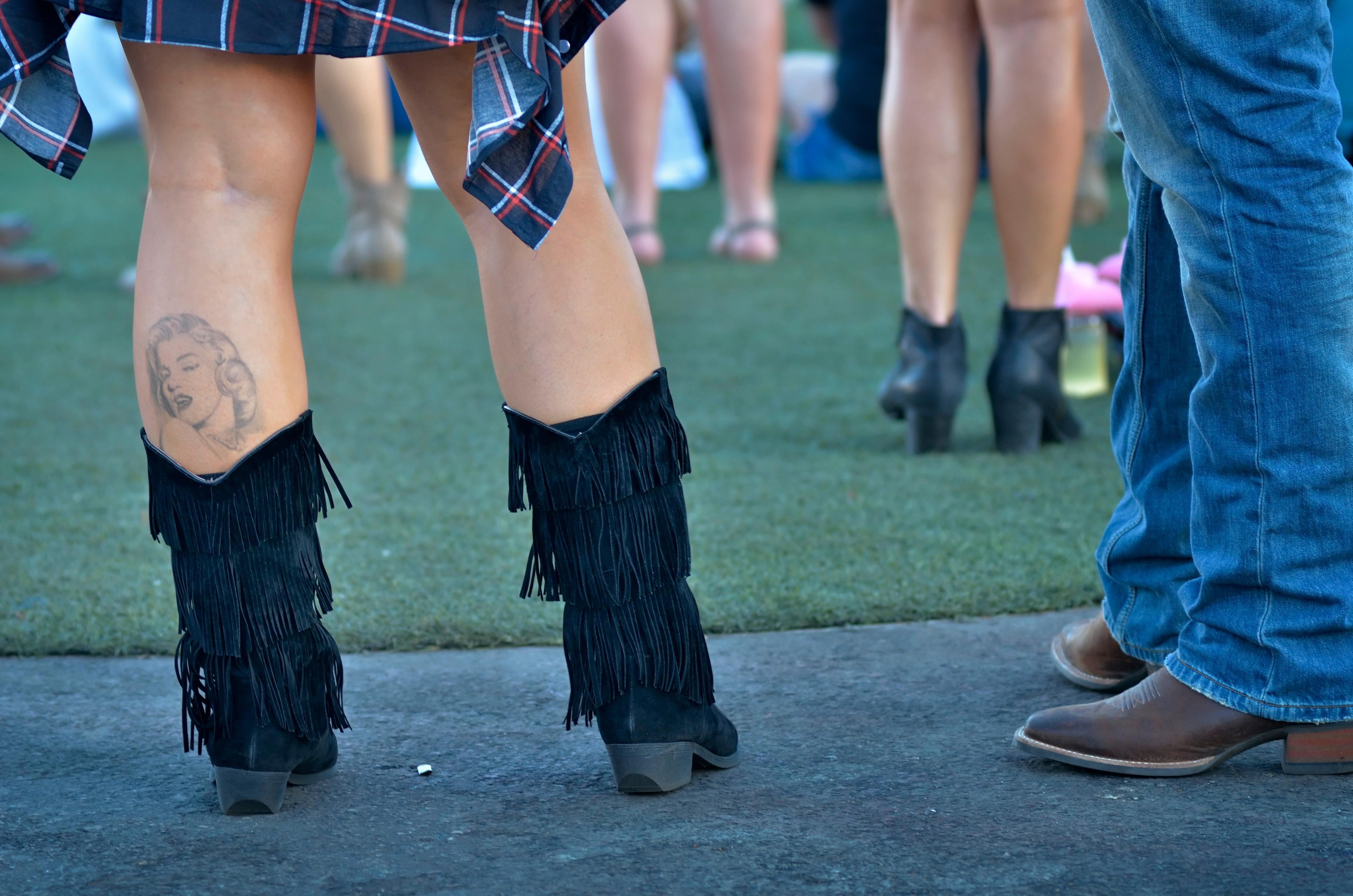 Melissa Handley sports a Marilyn Monroe tattoo above her boots at the Route 91 Harvest festival on Las Vegas Boulevard South in Las Vegas on Saturday, Sept. 30, 2017.  [Bill Hughes/Las Vegas News Bureau]