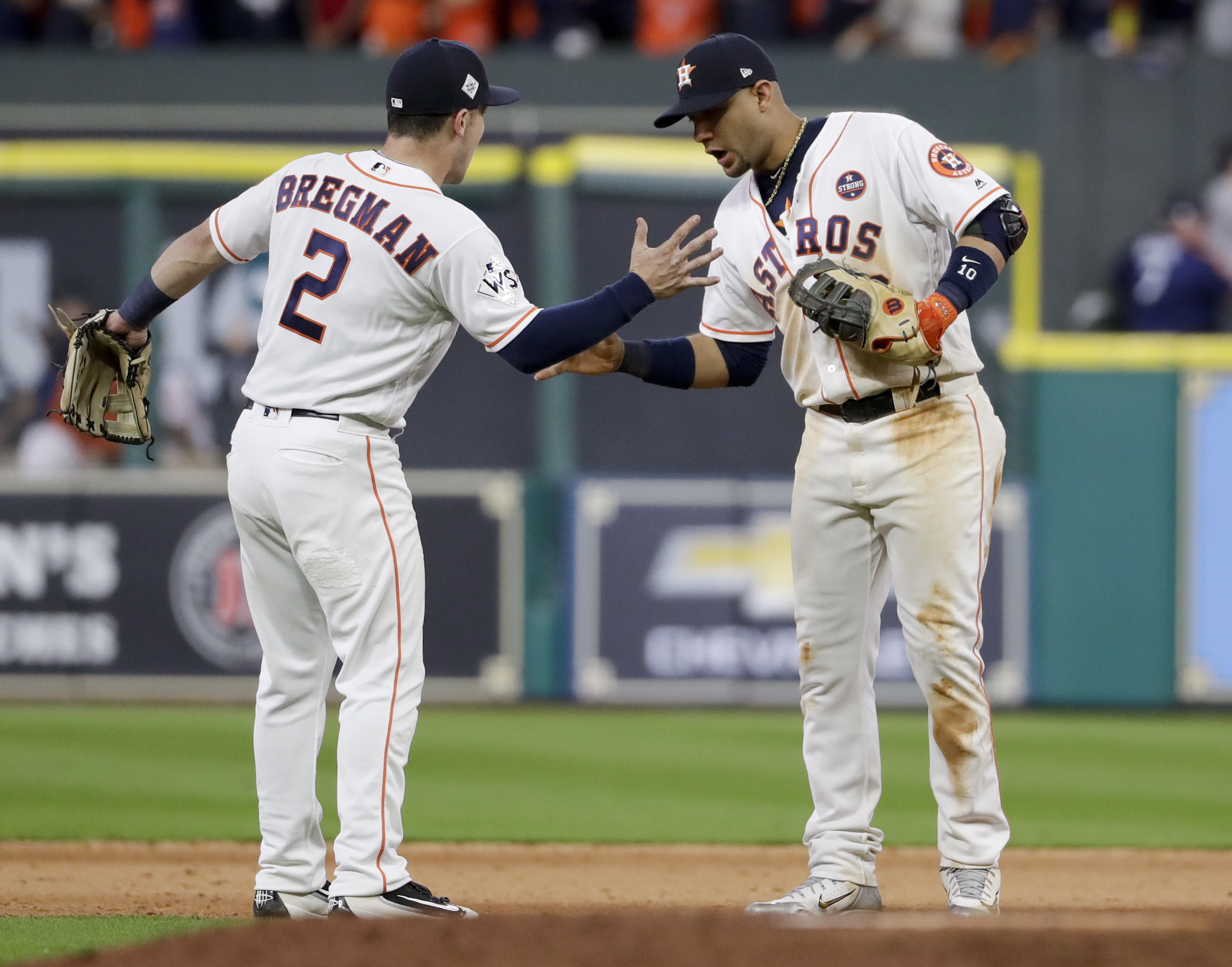 Houston Astros third baseman Alex Bregman, left, and first baseman Yuli Gurriel celebrate after their win against the Los Angeles Dodgers during Game 3 of baseball's World Series Friday, Oct. 27, 2017, in Houston. The Astros won 5-3 to take a 2-1 lead in the series. (AP Photo/Matt Slocum)