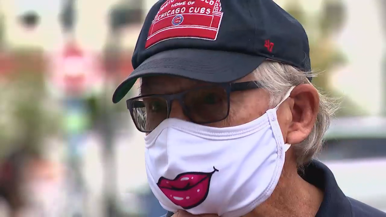Bill Whiting sports a whimsical mask with red lips while talking to News 13 in downtown Asheville. (Photo credit: WLOS Staff)