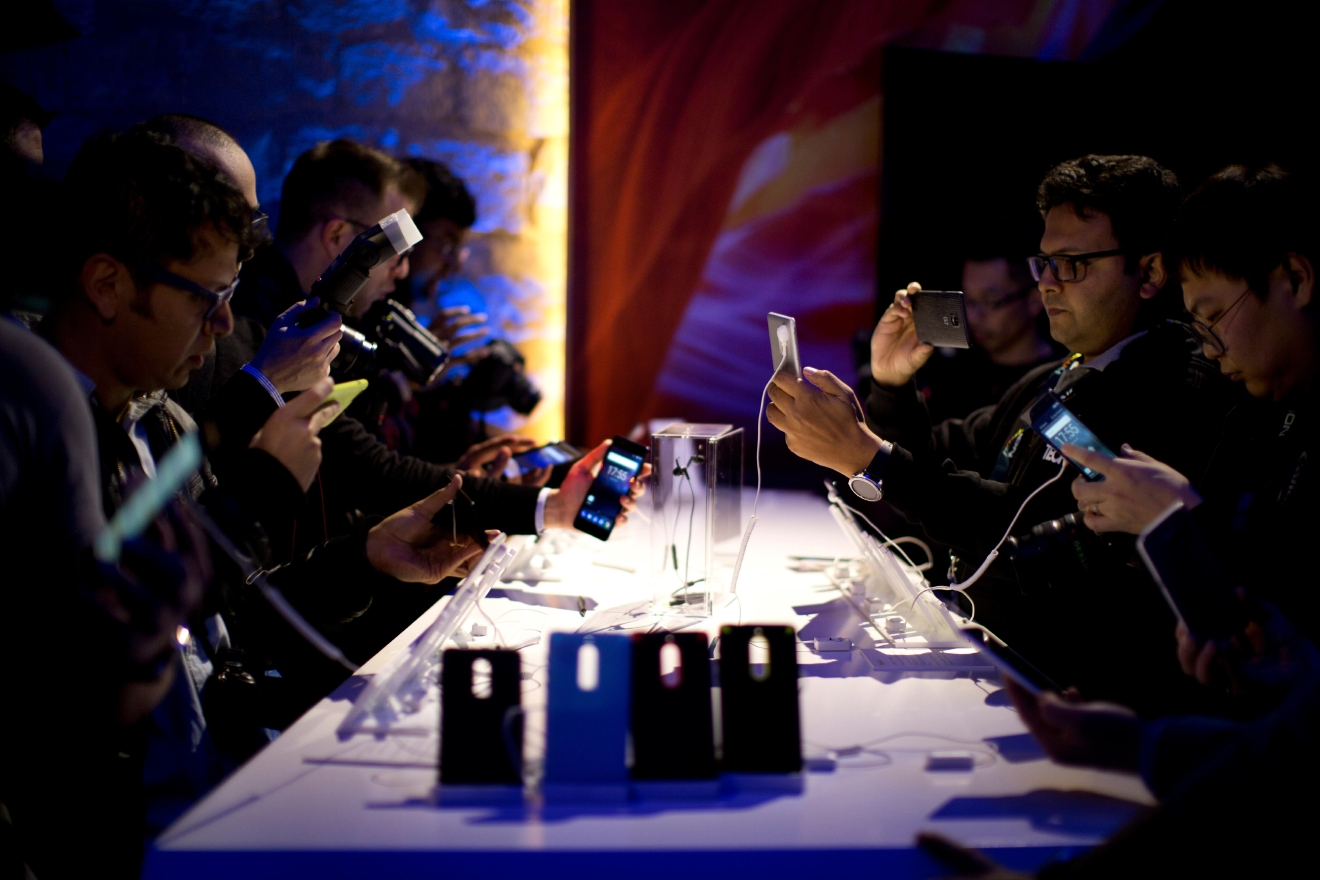 Attendees check the new Nokia 5 smartphone, during a Nokia presentation ahead of Monday's opening of the Mobile World Congress wireless show in Barcelona, Spain, Sunday, Feb. 26, 2017. Finland-based HMD Global is re-launching the simple Nokia 3310 model along with unveiling three new devices at Mobile World Congress in Barcelona. (AP Photo/Emilio Morenatti)