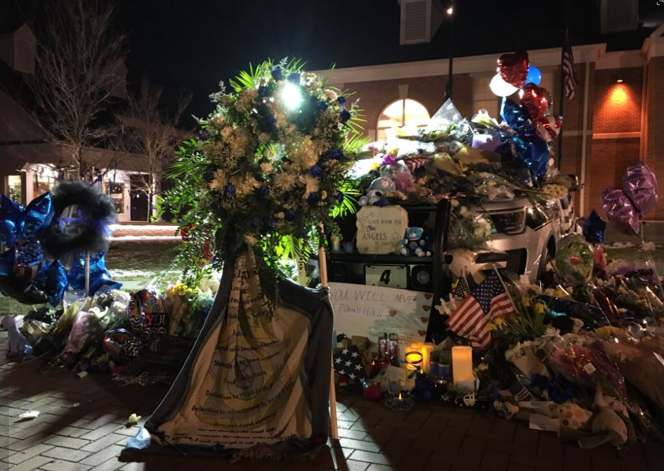 Officer Morelli's cruiser has been turned into a memorial in front of the Westerville Police station, where many people have stopped by to leave mementos (WSYX/WTTE)<p></p>