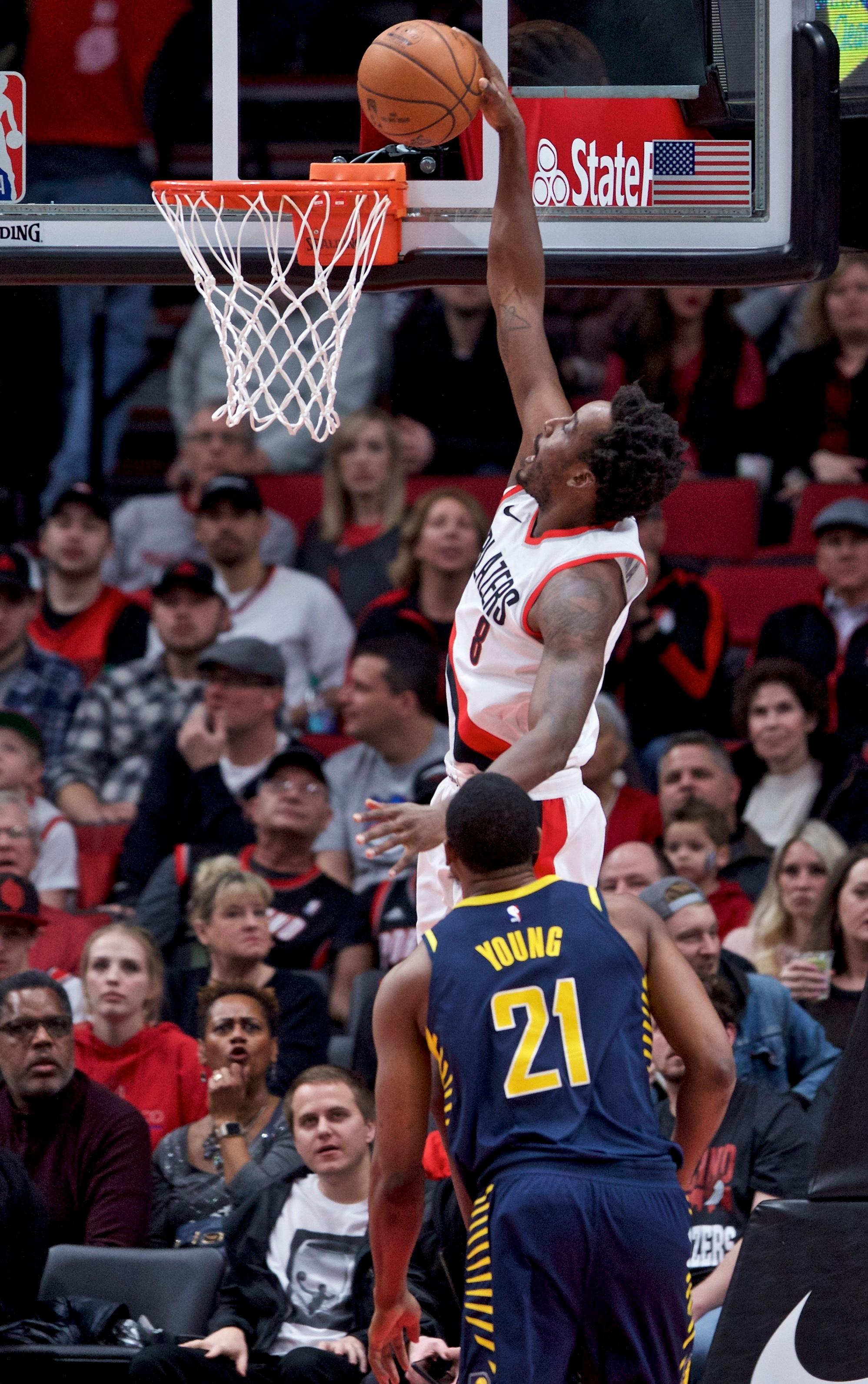 Portland Trail Blazers forward Al-Farouq Aminu, top, dunks over Indiana Pacers forward Thaddeus Young during the first half of an NBA basketball game in Portland, Ore., Thursday, Jan. 18, 2018. (AP Photo/Craig Mitchelldyer)