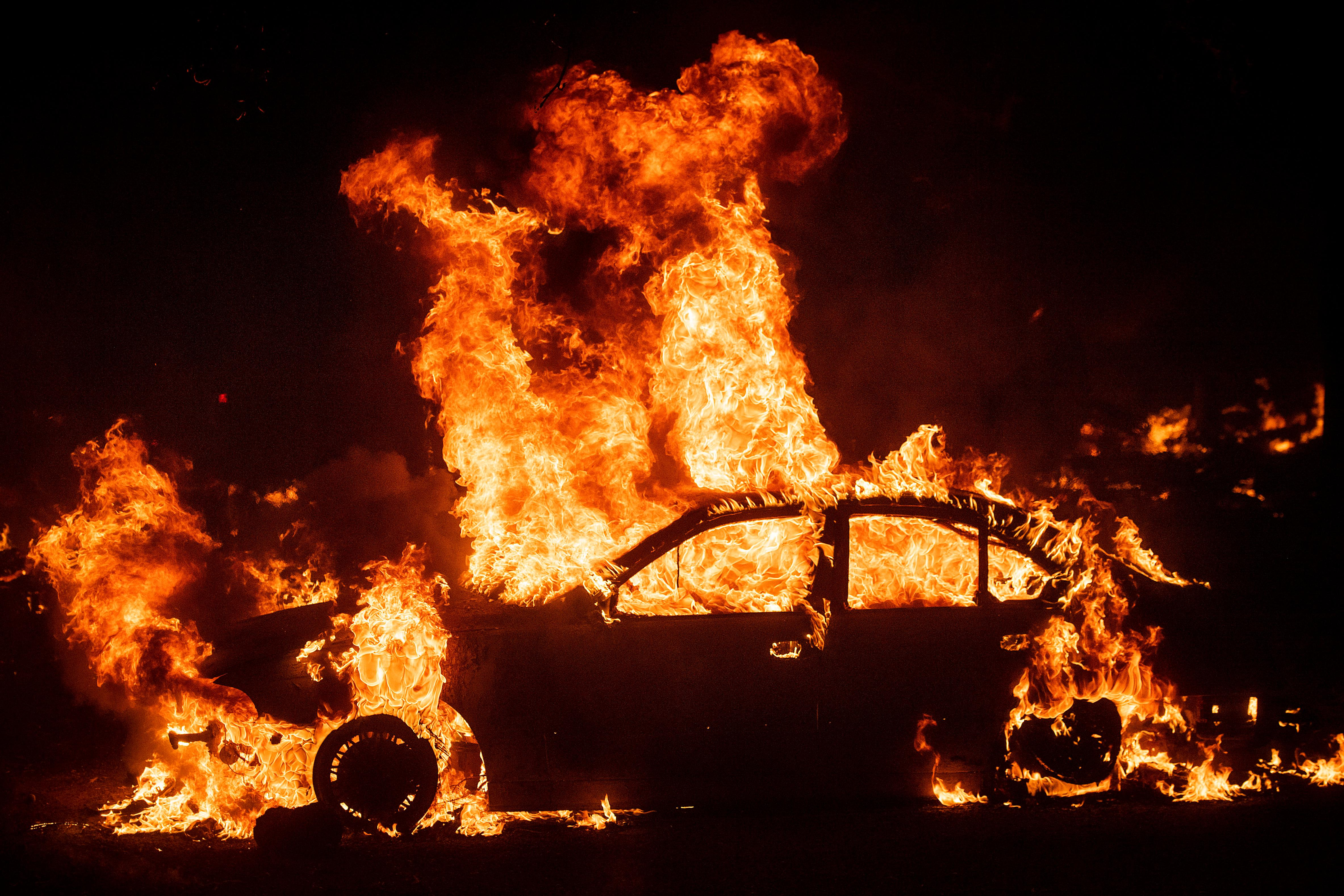 Flames from the Kincade Fire consume a car in the Jimtown community of unincorporated Sonoma County, Calif., on Thursday, Oct. 24, 2019. (AP Photo/Noah Berger)