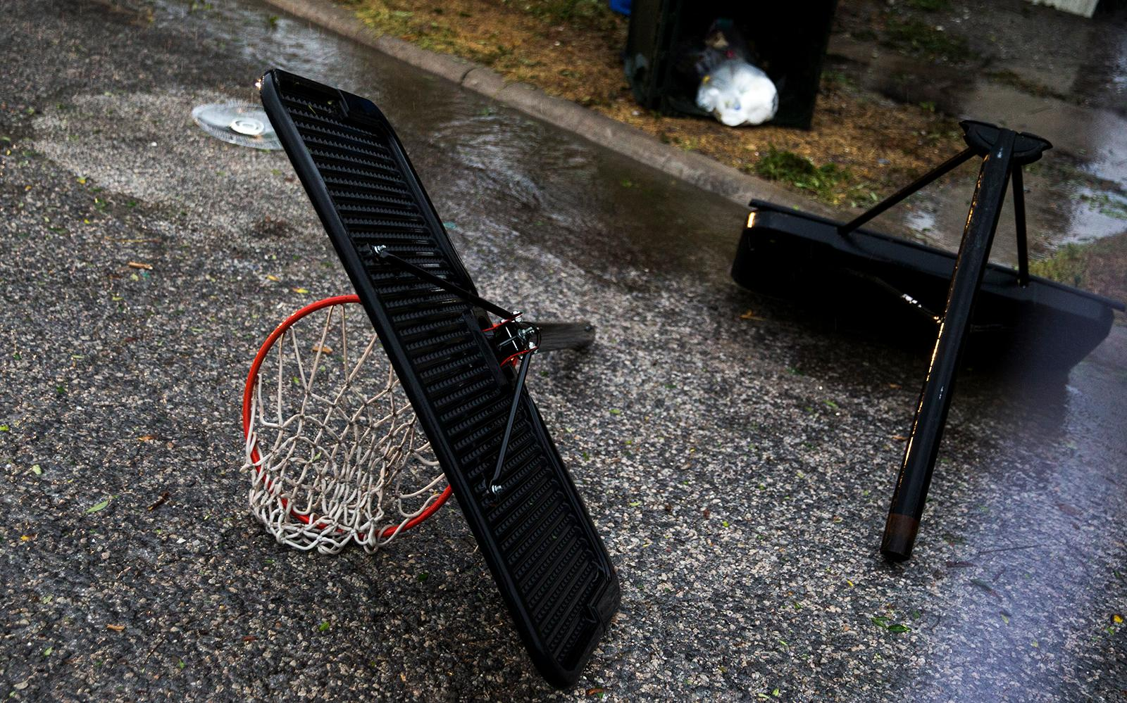 A basketball hoop lays in pieces as Hurricane Harvey makes landfall in Corpus Christi, Texas, on Friday, Aug. 25, 2017. Hurricane Harvey smashed into Texas late Friday, lashing a wide swath of the Gulf Coast with strong winds and torrential rain from the fiercest hurricane to hit the U.S. in more than a decade.  (Nick Wagner/Austin American-Statesman via AP)