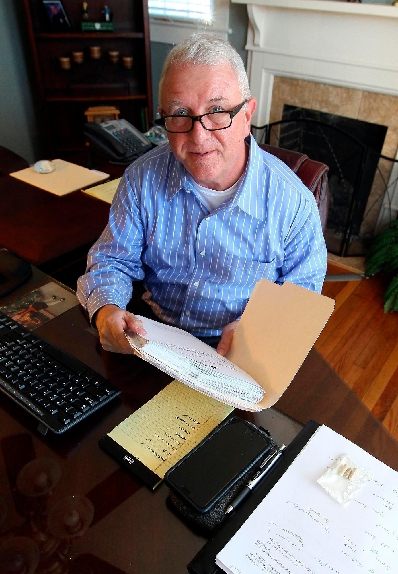 This 2017 photo shows Roger Self in his office at Southeastern Loss Management, in Dallas, N.C. Police say that Self intentionally rammed a vehicle into a restaurant shortly after midday Sunday, May 20, 2018, in Bessemer City, N.C., leaving his 26-year-old daughter and one other person dead and several others injured. Self was immediately arrested. Jail records show he's been charged with two counts of first-degree murder. (John Clark/The Gaston Gazette via AP)