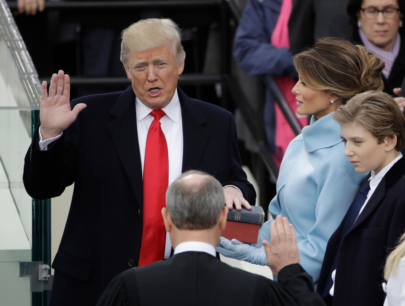 Donald Trump is sworn in as the 45th president of the United States by Chief Justice John Roberts as Melania Trump looks on during the 58th Presidential Inauguration at the U.S. Capitol in Washington, Friday, Jan. 20, 2017. (AP Photo/Matt Rourke) '