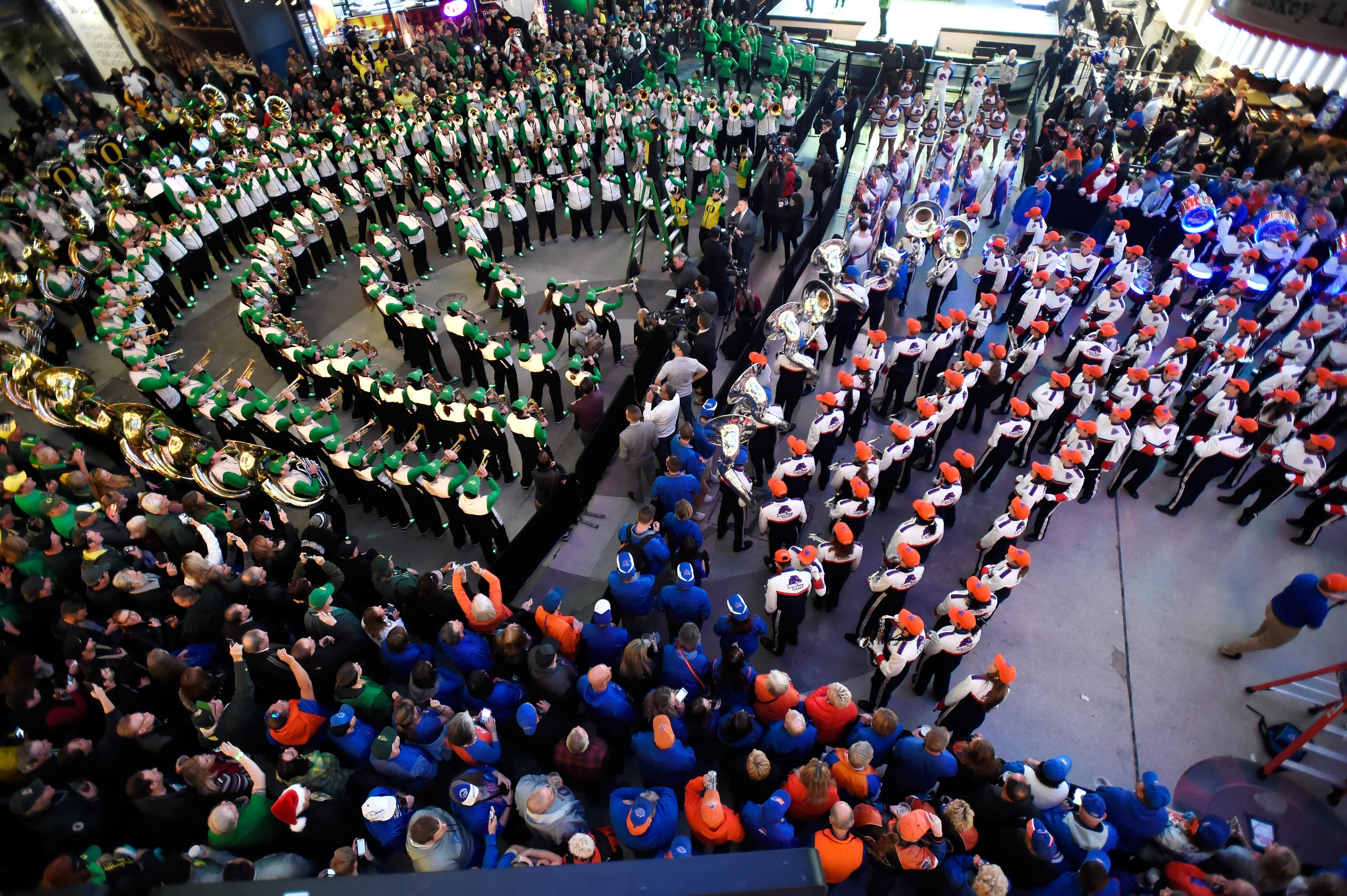 The Oregon and Boise State marching bands participate during a pep rally at the Fremont Street Experience Friday, Dec. 15, 2017, in Las Vegas. The Boise State Bronco will take on the Oregon Ducks in the 26th edition of the Las Vegas Bowl at Sam Boyd Stadium on Saturday. CREDIT: David Becker/Las Vegas News Bureau