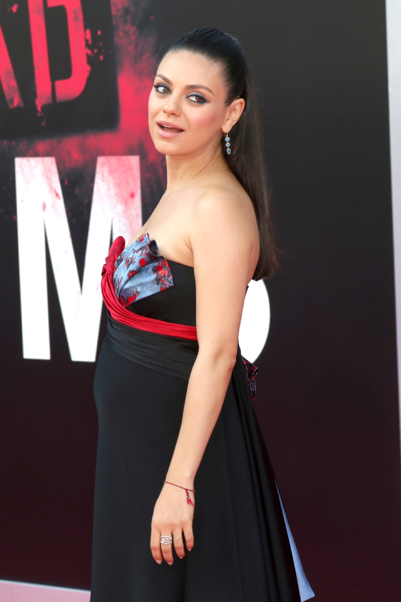 "Mila Kunis attends the premiere of ""Bad Moms"" (Nicky Nelson/WENN.com)"