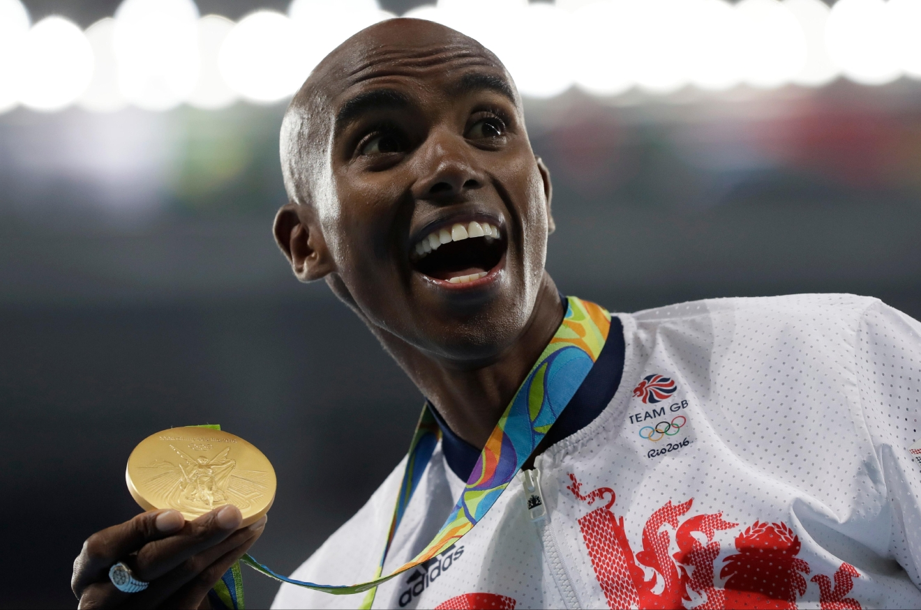Britain's Mo Farah celebrates with the gold medal after the men's 10,000-meter final during the athletics competitions of the 2016 Summer Olympics at the Olympic stadium in Rio de Janeiro, Brazil, Saturday, Aug. 13, 2016. (AP Photo/Kirsty Wigglesworth)