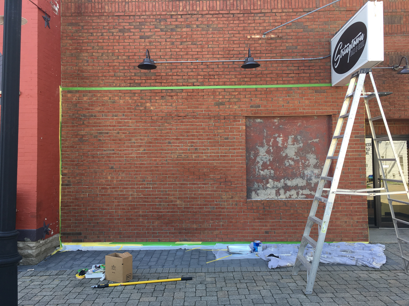 Stringtown's wall prior to Josh's mural / Image courtesy of Josh Stout // Published: 8.10.19<p></p>