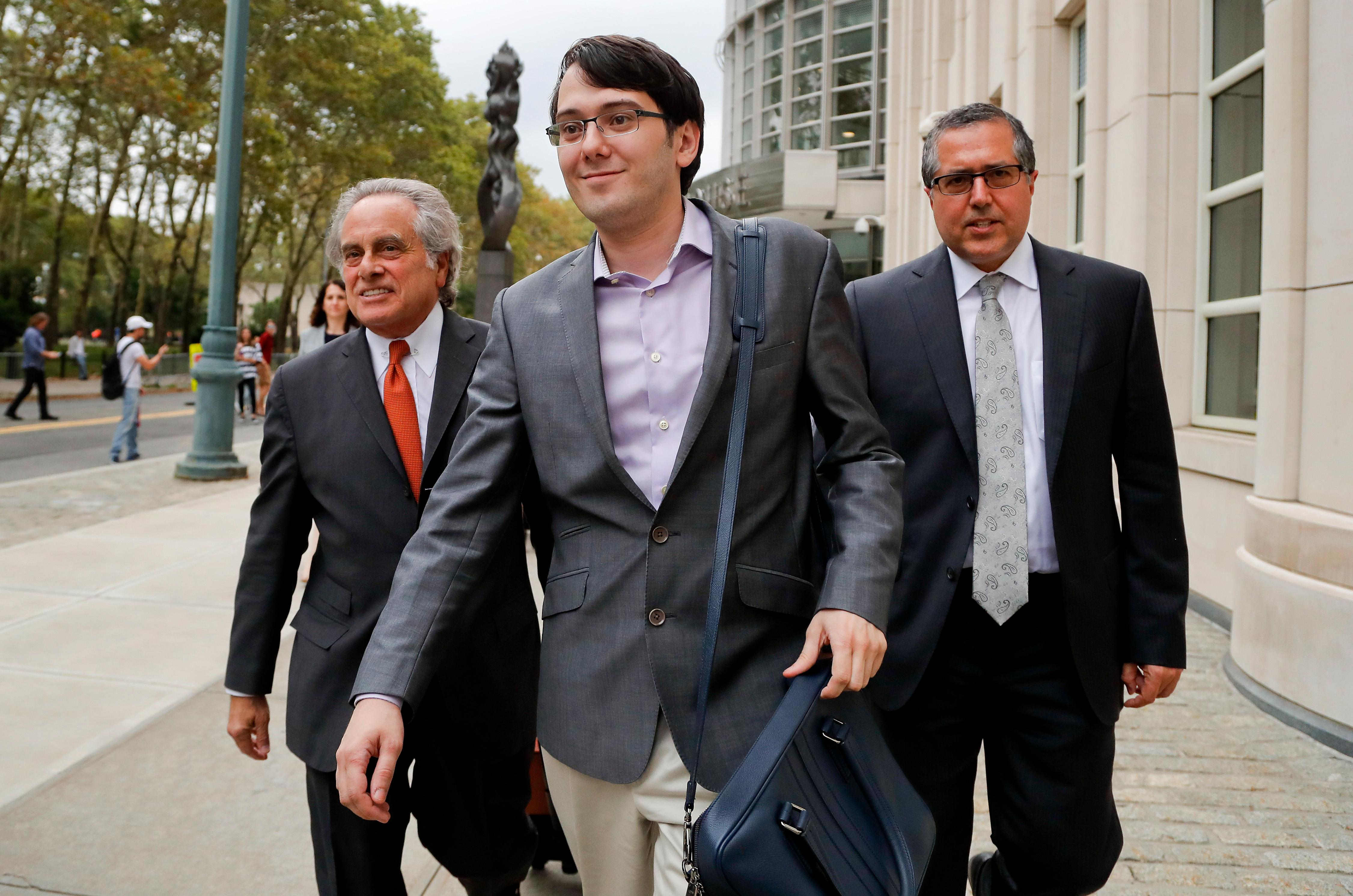 FILE - In this Thursday, July 27, 2017, file photo, former biotech CEO Martin Shkreli, center, leaves federal court with his attorney Benjamin Brafman, left, in New York.  (AP Photo/Julie Jacobson, File)