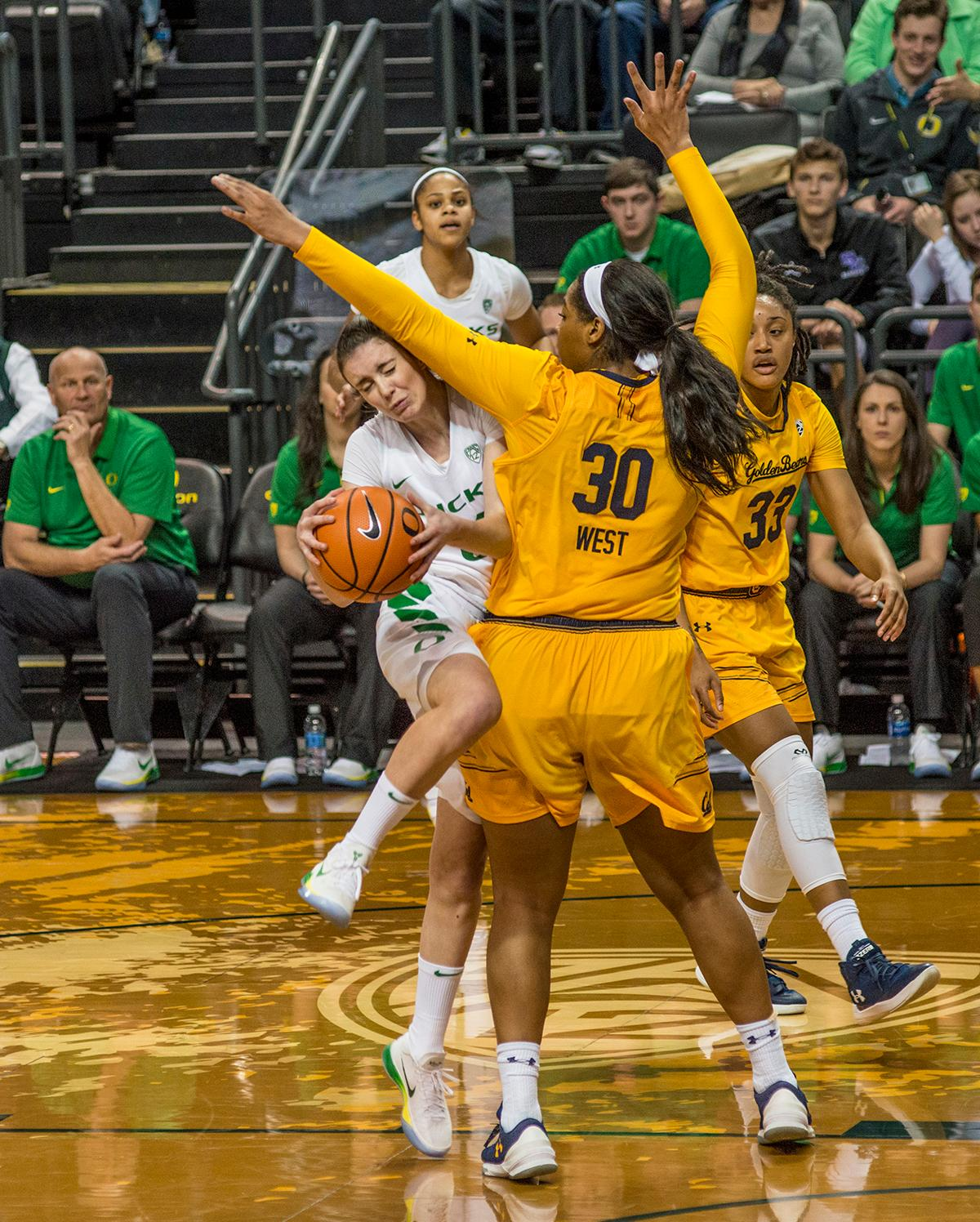 Oregon Ducks Aina Ayuso (#31, with ball) gets blocked by Cal Golden Bears CJ West (#30). The Oregon Ducks women defeated the Cal Bears 91-54 in Matthew Knight Arena Saturday evening. The Ducks had three players in double digits: Sabrina Ionescu with 28 points; Ruthy Hebard with 18 points; and Satou Sabally with 10 points. The Ducks now stand at 10-1 in conference play and Cal drops to 6-5. Photo by Dan Morrison, Oregon News Lab