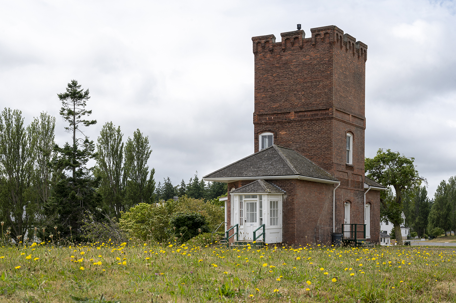 Alexander's Castle sits atop a grassy hill overlooking Admiralty Bay at Fort Worden State Park. The historic landmark, that very much resembles a chess rook, was built by Reverend John Alexander in 1882 for his fiancee — only to find later she had married another while they were apart. (Rachael Jones / Seattle Refined)