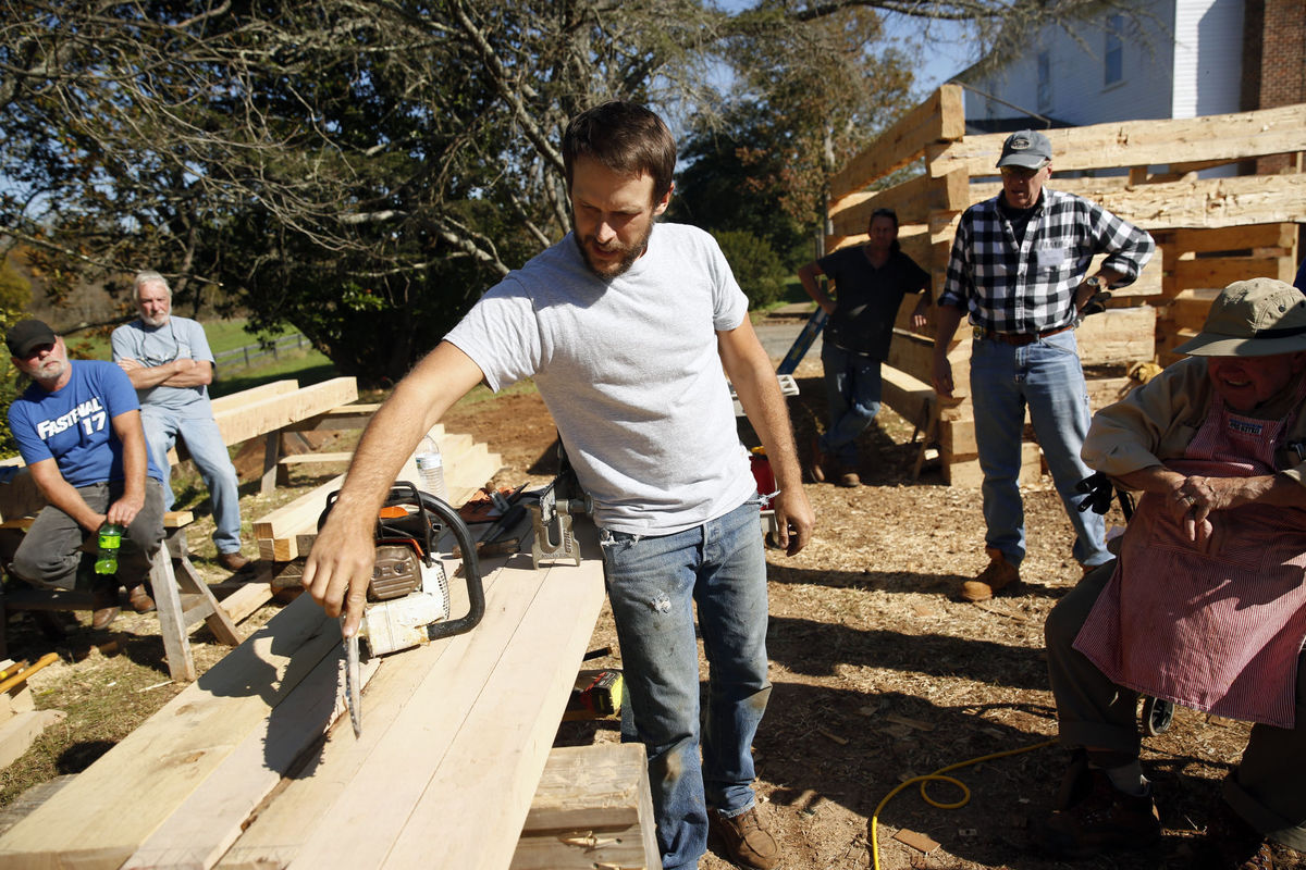 James Madison's Montpelier and Salvagewrights Ltd. occasionally offer log cabin workshops. Participants learn authentic building technqiues and use a mix of antique and modern tools. (Photo: Suzanne Carr Rossi/The Free Lance-Star)