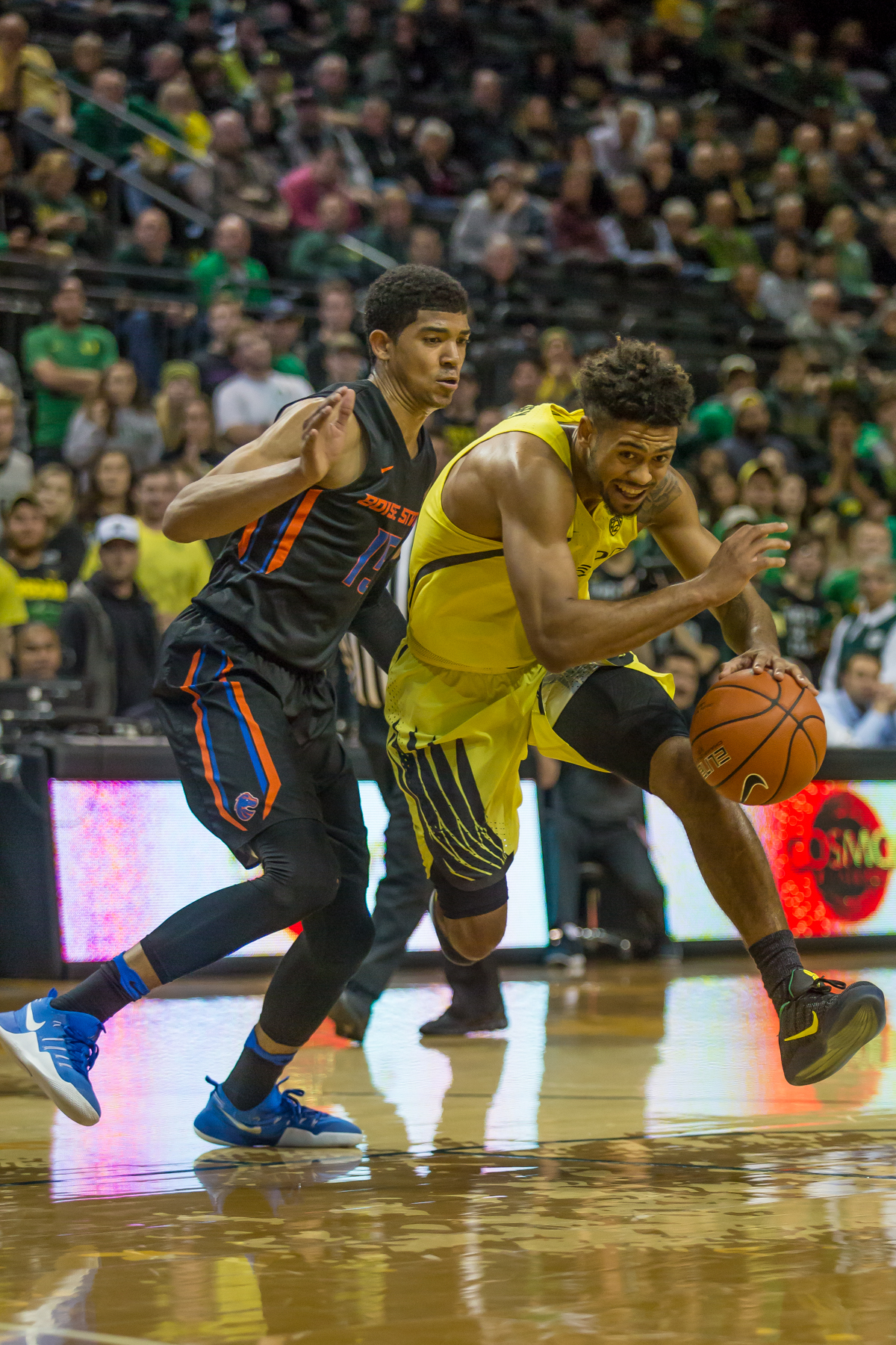 Oregon guard Tyler Dorsey (#5) drives past Boise State guard Chandler Hutchinson (#15). After trailing for most of the game, the Oregon Ducks defeated the Boise State Broncos 68-63. Photo by Dillon Vibes