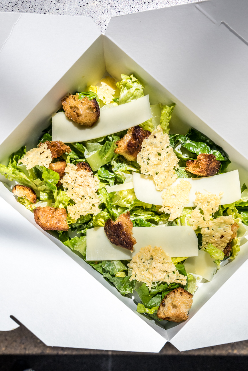 Caesar salad: Parmesan Crisps, house-made Caesar dressing, and garlic croutons / Image: Catherine Viox{ }// Published: 5.16.20