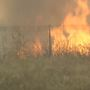 Winds keep grass fire burning in Leonard Mountain area