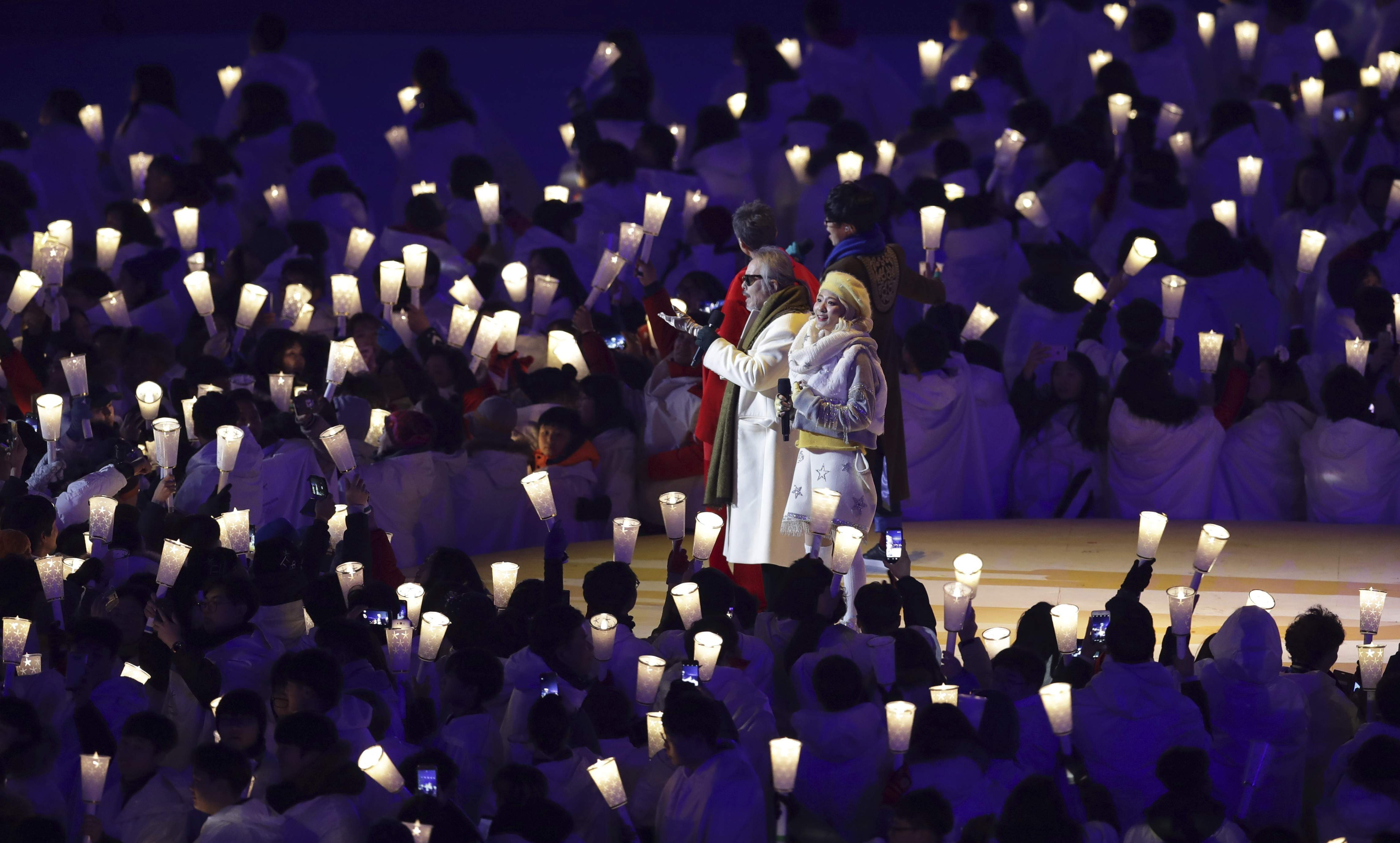 Singers from left Ha Hyun-woo, Lee Eun-mi, Jeon In-kwon and Ahn Ji-young perform during the opening ceremony of the 2018 Winter Olympics in Pyeongchang, South Korea, Friday, Feb. 9, 2018. (AP Photo/Michael Sohn)