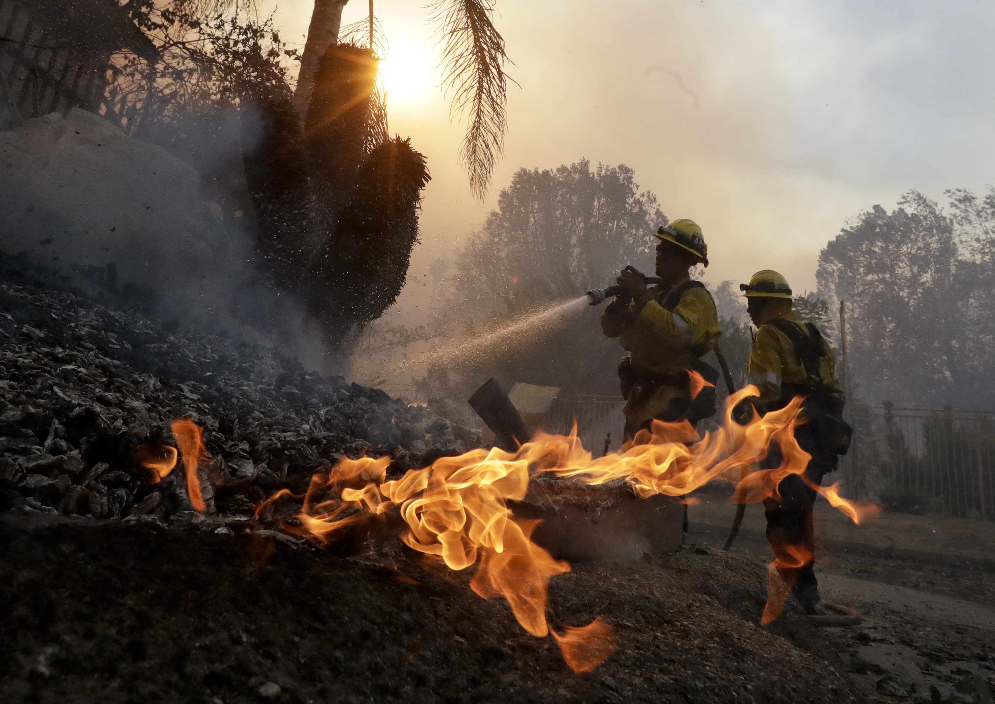 Los Angeles County firefighters battle a wildfire in the Lake View Terrace area of Los Angeles, Tuesday, Dec. 5, 2017. (AP Photo/Chris Carlson)