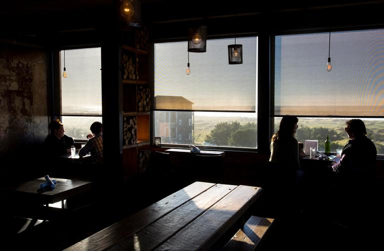 The view at Pickled Fish looks out over the ocean at Long Beach. (Sy Bean / Seattle Refined)