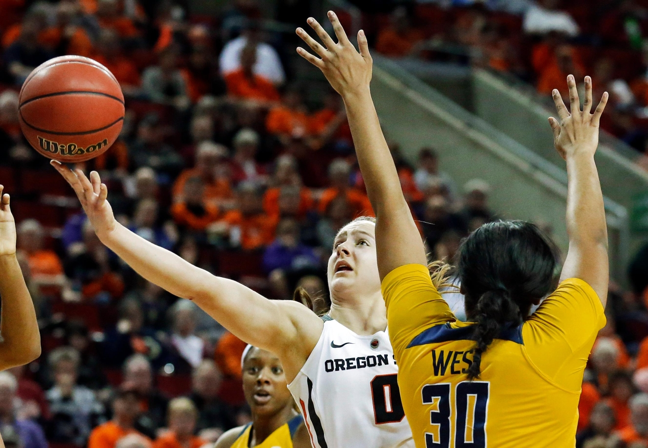 Oregon State guard Mikayla Pivec (0) puts up a shot against California forward CJ West (30) in the first half of an NCAA college basketball game in the Pac-12 Conference tournament, Friday, March 3, 2017, in Seattle. (AP Photo/Ted S. Warren)