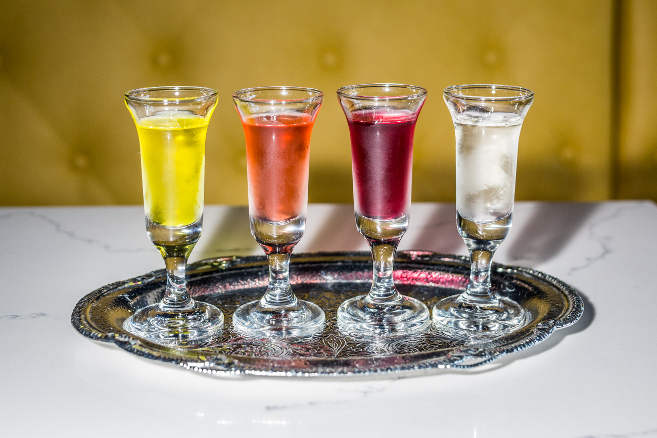 <p>Infused Wódka Flight: ginger + tumeric, strawberry, hibiscus + rose petal + red currant, and KY Colonel Mint / Image: Catherine Viox // Published: 6.28.19</p>