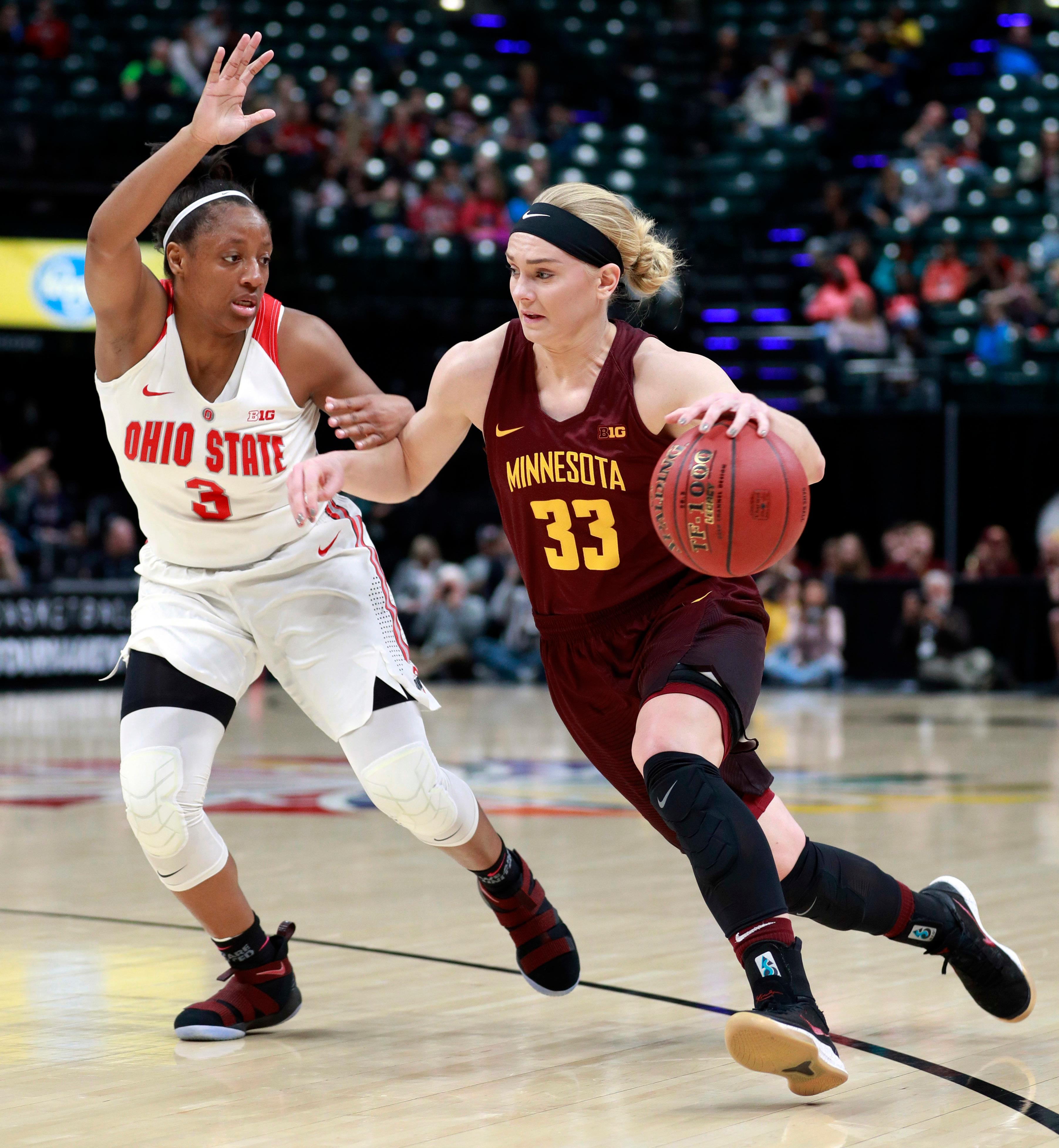 Minnesota guard Carlie Wagner (33) drives against Ohio State guard Kelsey Mitchell during the first half of an NCAA college basketball game in the semifinals of the Big Ten women's tournament Saturday, March 3, 2018, in Indianapolis. (AP Photo/R Brent Smith)