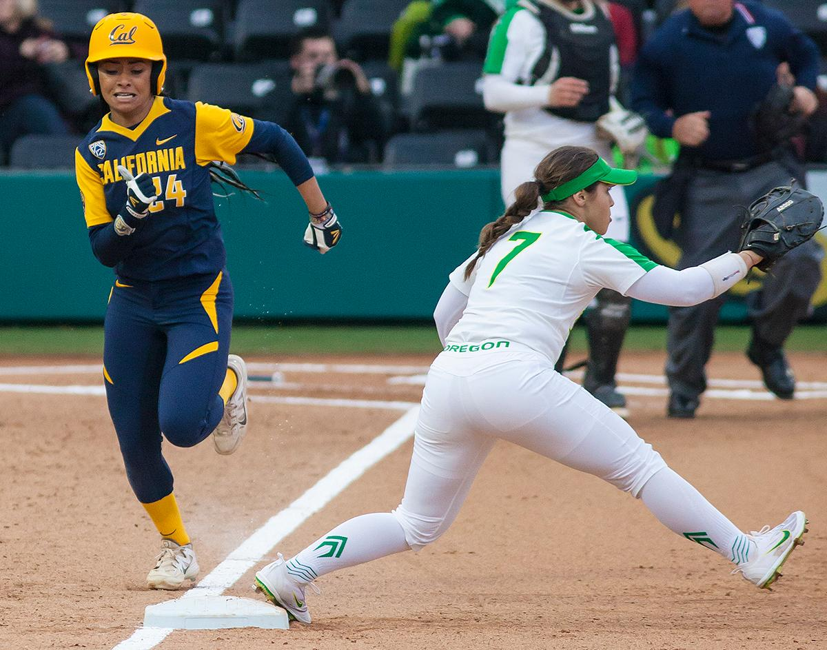 California utility player Jazmyn Jackson sprints toward first base as Oregon infielder Mia Camuso awaits a pass. California infielder Bradie Fillmore (#4) catches the ball before tagging out Oregon utility player Lauren Lindvall (#8). In the first of a three game series the Oregon Ducks defeated the California Golden Bears five to one. Photo by Ben Lonergan, Oregon News Lab