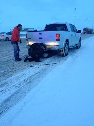 Oklahoma County Sheriff deputies assisting folks on I40 near I35 junction Changing a tire