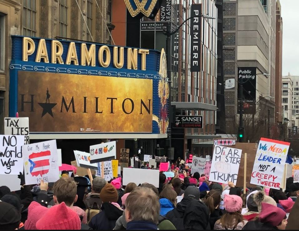 Marchers pass the Parmount Theatre in Seattle. (Photo: KOMO News)<p></p>