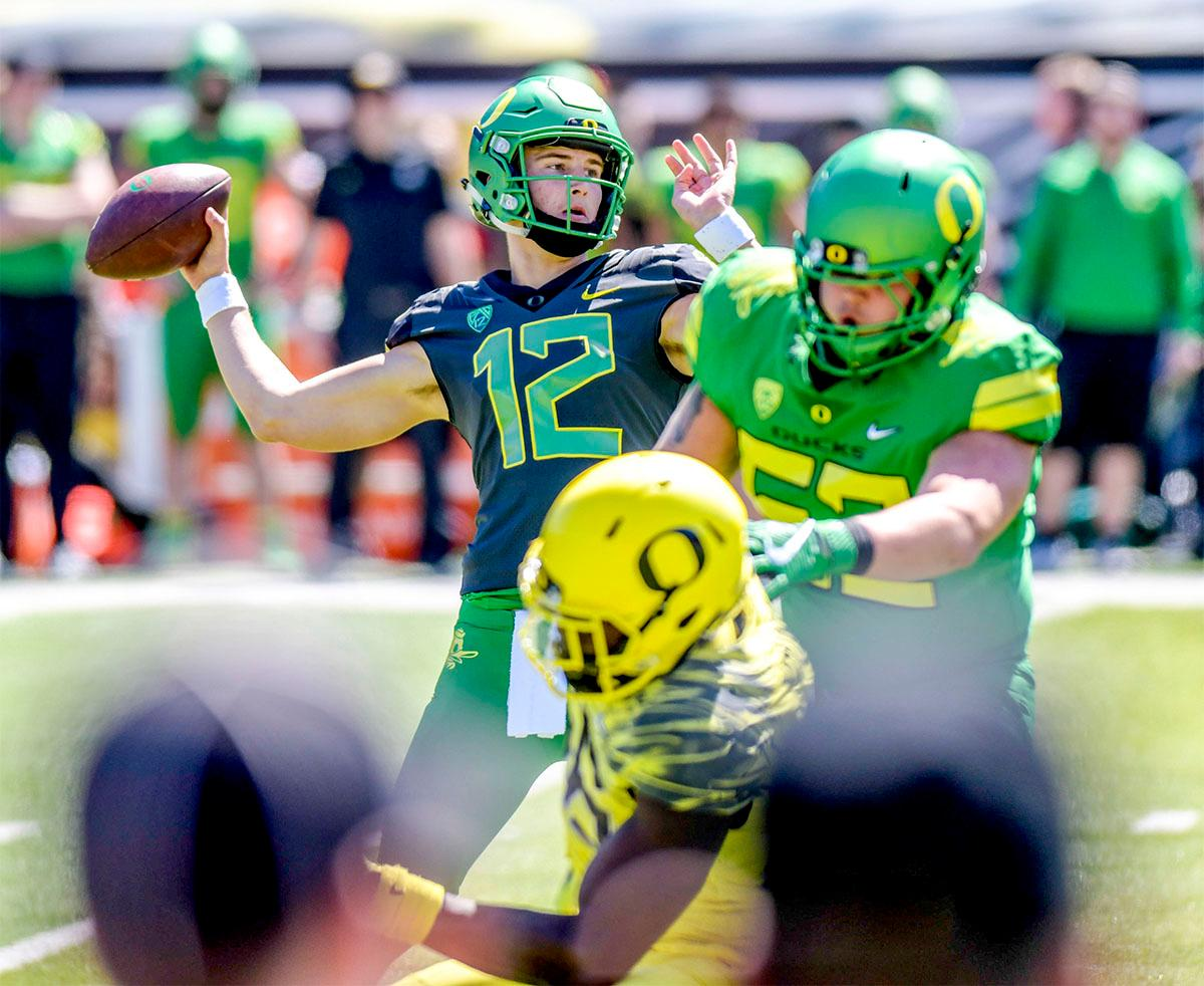 Tyler Shough (#12) prepares to throw the ball down field. The Thunder defeated the Lightning 59-24 in the Spring Game on Saturday at Autzen Stadium. Photo by August Frank