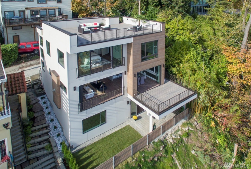 This brand new, eco-friendly, and drop dead gorgeous home sits on the shores of Lake Washington in the the Leschi Neighborhood. The luxury home has a price tag of $2,748,888 and it's a real dream, let me tell you.  (Image: Drone footage).