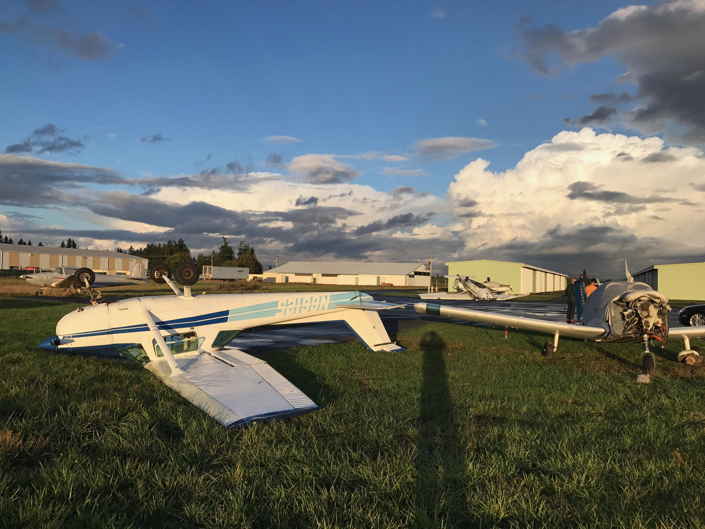 A small tornado flipped over this plane and one other at the Aurora State Airport on Thursday afternoon, Oct. 12, 2017. It also caused minor damage to a building and a nearby greenhouse. (Photo: Aurora Aviation Inc.)