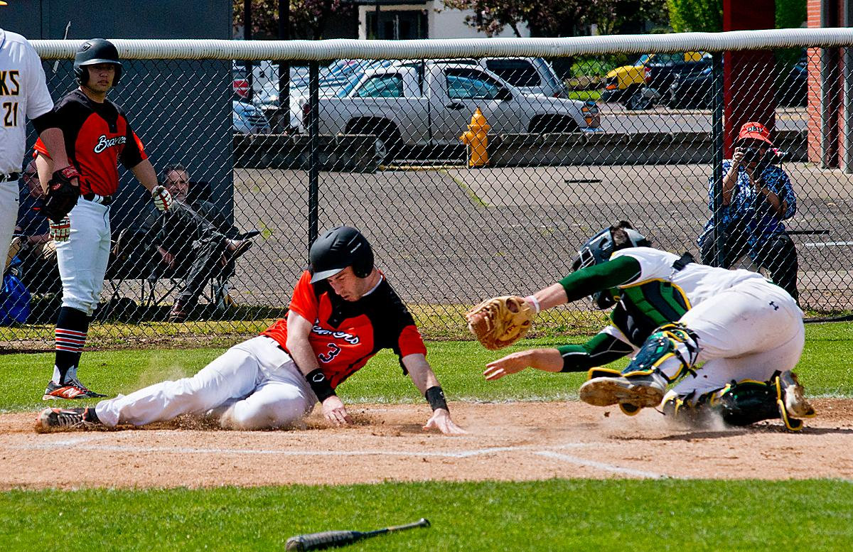 The Oregon State Beavers runner gets past the Oregon Ducks catcher Jack McWilliams for a score.. The Oregon Ducks won the Civil War series this weekend against the Oregon State Beavers. The Ducks won the first game 13-3, but lost the second game 12-0, then rebounding to win the third and deciding game 4-3. The Ducks Club baseball team finished the season with a league record of 14-1, taking first place. They now move on to the Regionals in Boise, Idaho, in two weeks. The Club team won the National Championship in 2015 and came in third nationally in 2016. Photo by Dan Morrison, Oregon News Lab