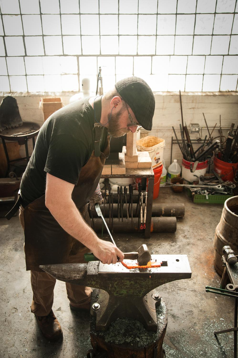 Mark Gilsdorf, Artist-Blacksmith, works in his studio in the Essex Studios building in Walnut Hills. / Image: Melissa Doss Sliney