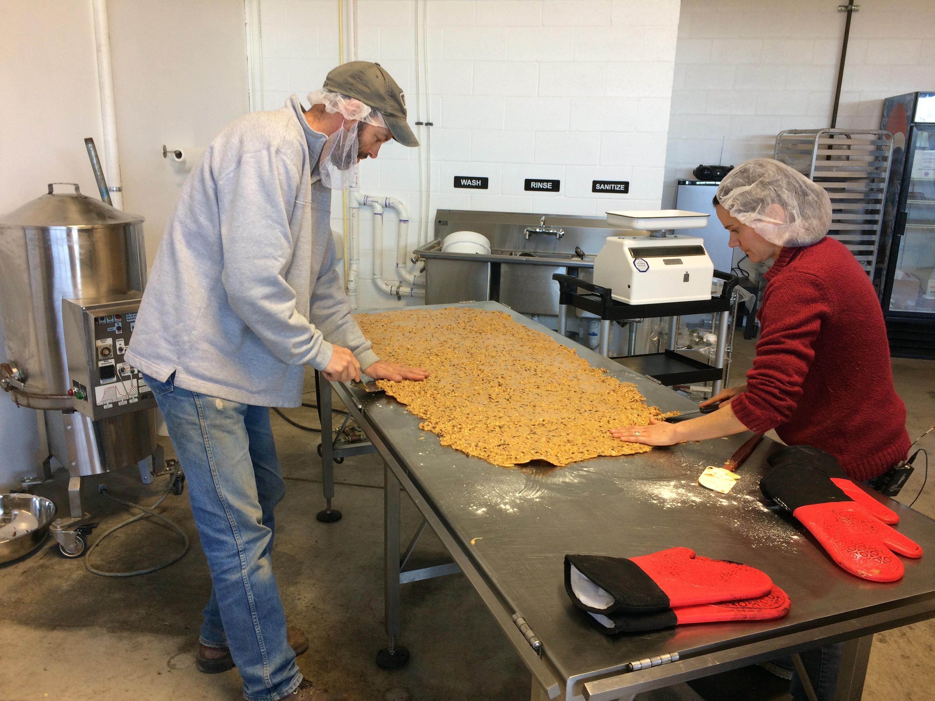 Ryan and Rachel Henderson make hazelnut brittle, toffee and chocolate during their busiest season of the year. Photo by Audrey Weil.<p></p>