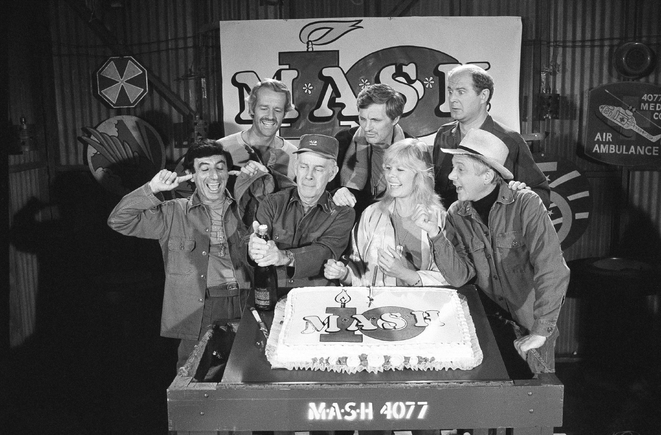 "FILE- IN this Oct. 22, 1981, file photo, Jamie Farr, left, plugs his ears, as cast members of the ""M*A*S*H"" television series cast from front left, Harry Morgan, Loretta Swit, William Christopher, and from back from left, Mike Farrell Alan Alda and David Ogden Stiers celebrate during a party on the set of the popular CBS program in Los Angeles. Christopher died Saturday, Dec. 31, 2016. He was 84. (AP Photo/Huynh, File)"