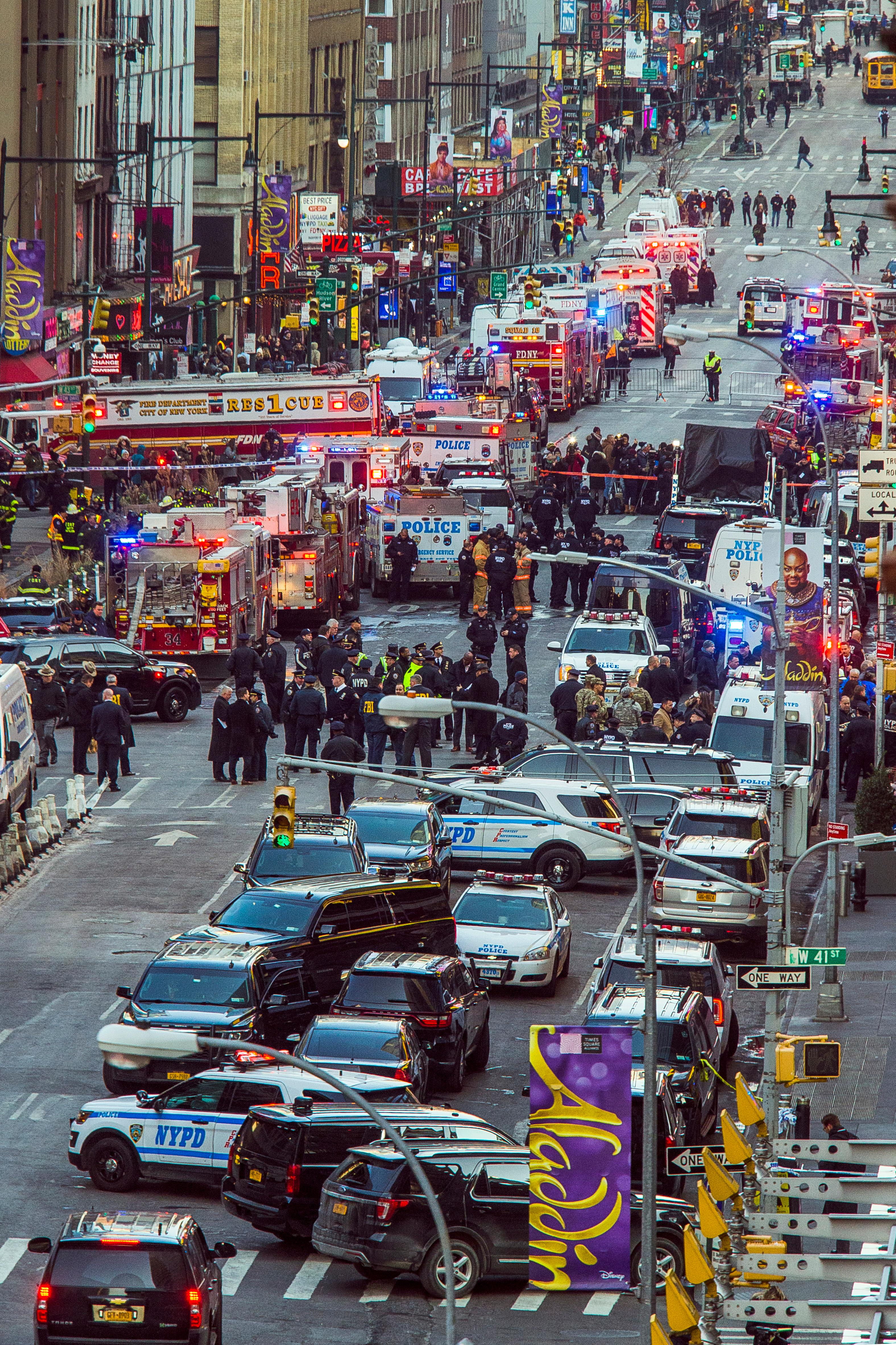 Law enforcement officials work following an explosion near New York's Times Square on Monday, Dec. 11, 2017. (AP Photo/Andres Kudacki)<p></p>