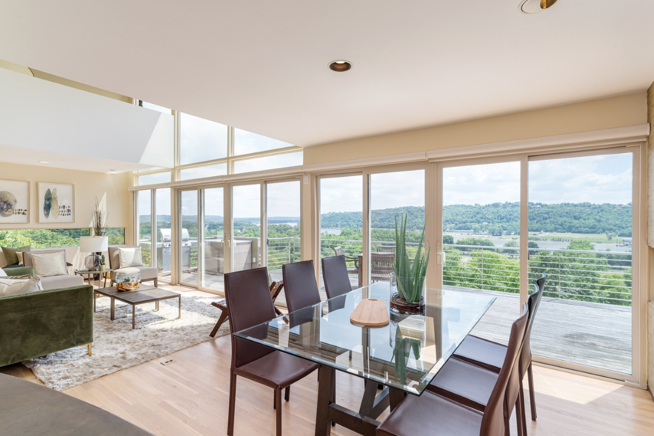 The dining room is open and spacious and offers great views of the river. / Image: Provided/Chris Farr, The First Showing, LLC. // Published: 7.21.20
