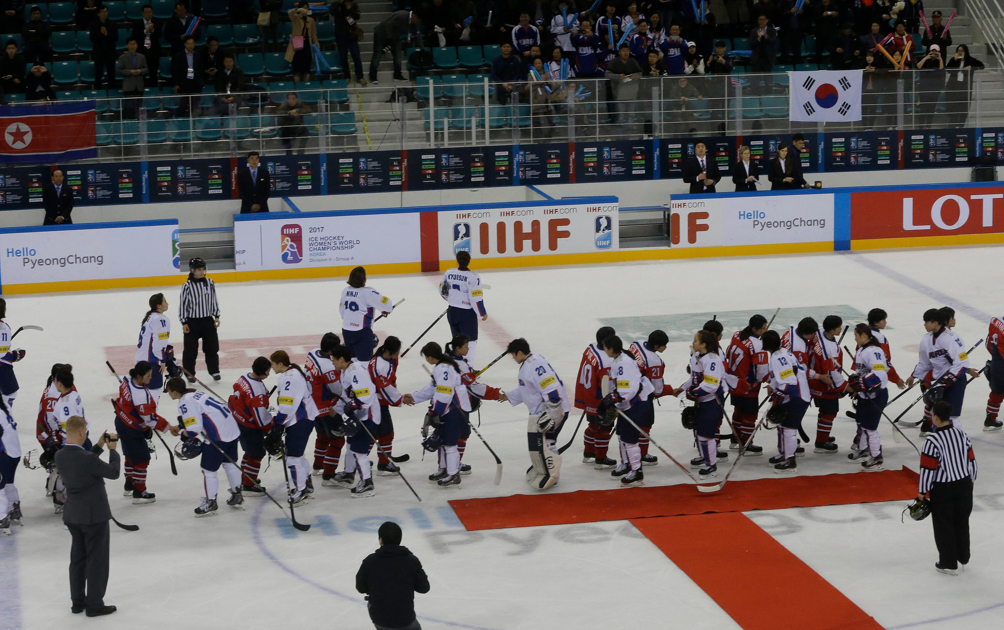 "FILE - In this April 6, 2017 file photo, South, wearing white uniforms, and North Korean players shake hands after their IIHF Ice Hockey Women's World Championship Division II Group A game in Gangneung, South Korea. During South and North Korea's talks at the border in about a week Wednesday, Jan. 17, 2018, senior officials from the two Koreas reached a package of deals including fielding a joint women's hockey team and conducting a joint march under a ""unification flag"" depicting their peninsula during the opening ceremony, according to Seoul's Unification Ministry. (AP Photo/Ahn Young-joon)"