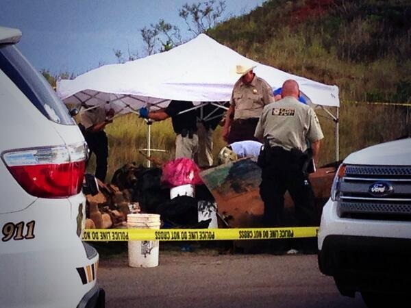 Officials gather evidence from one of the vehicles pulled out of Foss Lake.