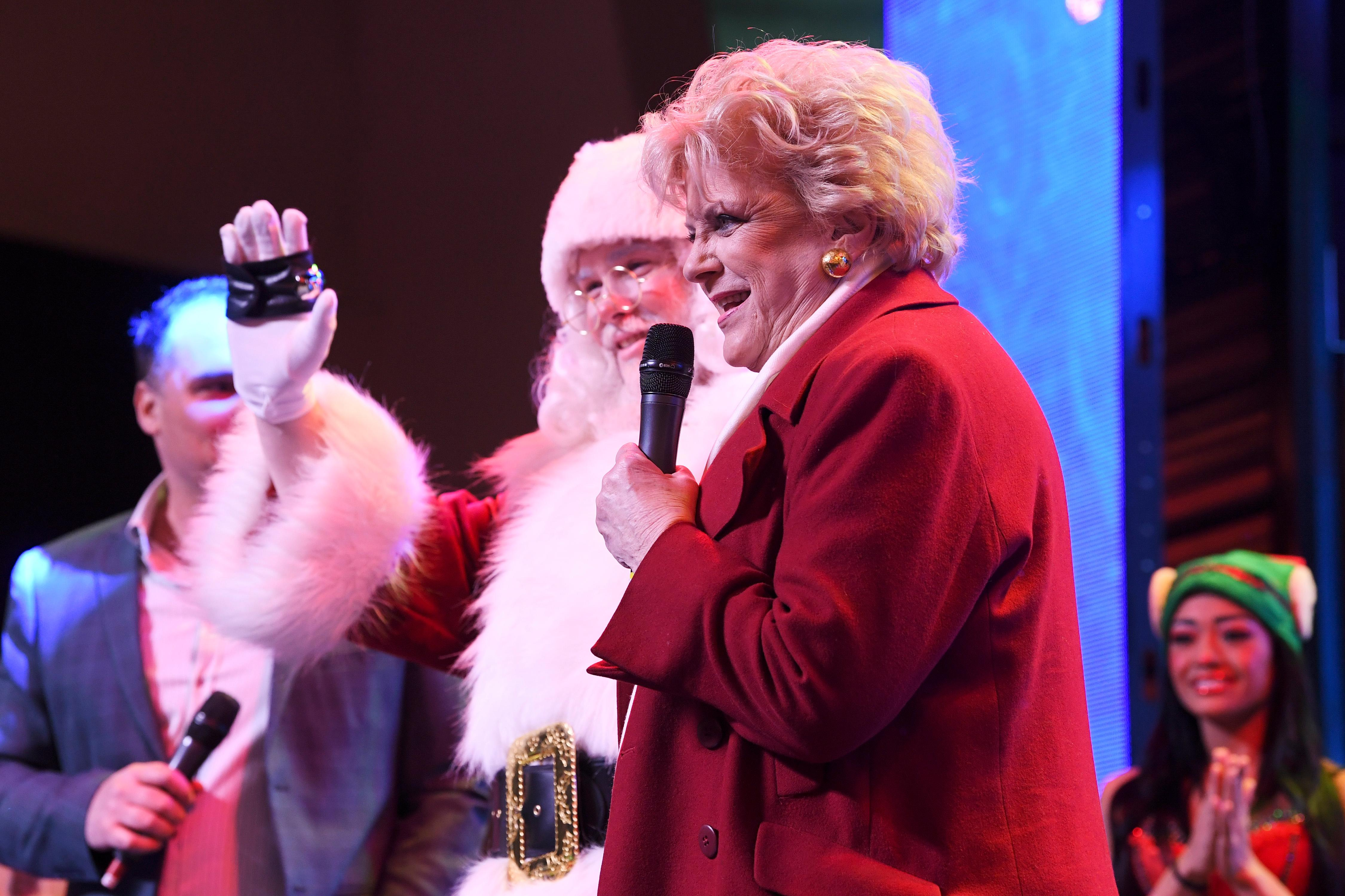 Las Vegas Mayor Carolyn Goodman is joined by a Santa during the annual lighting of a Christmas tree at the Fremont Street Experience Tuesday, December 4, 2018. CREDIT: Sam Morris/Las Vegas News Bureau