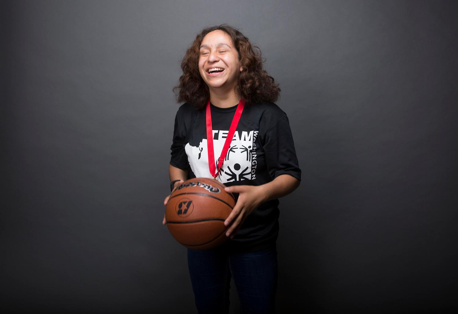 Introducing Melanie Hernandez! Melanie will be competing in basketball. The Special Olympics USA will take place in Seattle from July 1-6, with a grand opening ceremony and Parade of Athletes and the lighting of the Special Olympics Flame of Hope. (Sy Bean / Seattle Refined)